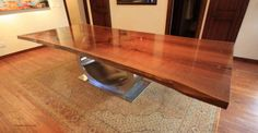 Refined Elements - Walnut Ellipse Table.  Bookmatched walnut top with sculpted stainless steel base.