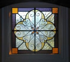 Stained Glass, Bevelled Glass  Wrought Iron. Pretty design, maybe brighter colors.