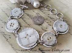 Hugs and Kiss Antique Carved Mother of Pearl Button Sterling Bracelet
