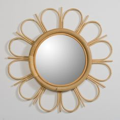 A daisy-shaped rattan mirror with a natural finish. Wall-mounted (fixings not supplied)Natural rattanNatural colour finishDiscover the full Yasu collection online. Rattan Rocking Chair, Bamboo Mirror, Flower Mirror, Luxury Duvet Covers, Luxury Bedding, Modern Bedding, Starburst Mirror, 70s Decor, Natural Bedding