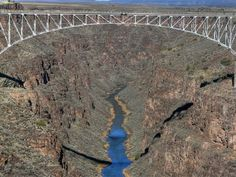 Have you seen the Rio Grande Gorge in New Mexico? This is one of the state's most impressive natural wonders, and it's incredibly beautiful. New Mexico Road Trip, Travel New Mexico, Taos New Mexico, New Mexico Usa, Rio Grande Gorge, Taos Ski Valley, New Mexican, Land Of Enchantment, Top Destinations