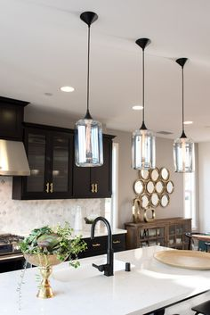 A classic black and gold kitchen deserves classic pendants!