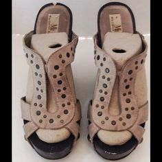 Mia Limited Edition Gray Leather Clog Mia Limited Edition gray leather clog.  Size 8 medium.  Gray leather wood wedge platform clogs.  Brass stud details on vamp and side of shoe.  There is a chip,on the heel,of one shoe, see pics. Mia Limited Edition Shoes Mules & Clogs