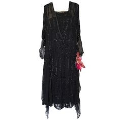 1920s Heavily Beaded & Sequin Flapper Dress | From a collection of rare vintage evening dresses at http://www.1stdibs.com/fashion/clothing/evening-dresses/