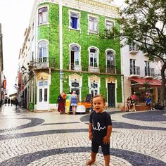 """Posing for the mamarazzi cause she loves green! Just love this old town, Lagos, Portugal 😍🌵 Traveling with kids around the world, making memories. """"Enjoy the little things, for one day you'll look back and realize they were the big things"""""""