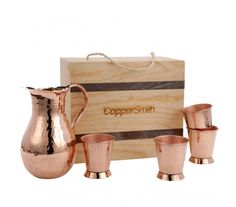 A delightful combination - a handcrafted copper pitcher with a 4 exquisite Jupiler cups. Perfect to bring your guest for a modest cocktail or lemonade on a hot Saturday afternoon. Copper Decor, Copper Art, Wooden Baby Toys, Kitchen Helper, 90s Kids, Lemonade, Metal Working, Tea Pots, Reusable Tote Bags