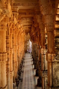 A nun in circambulation, in one of the 863 Jain Temples on top of the holy Shatrunjay Hill, near Palitana, Gujarat, India