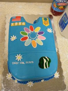 Daisy Girl Scout Cake - adorable!! Would be so cute when my girls get to the end of scouting to make a cake of each type of vest they've had.