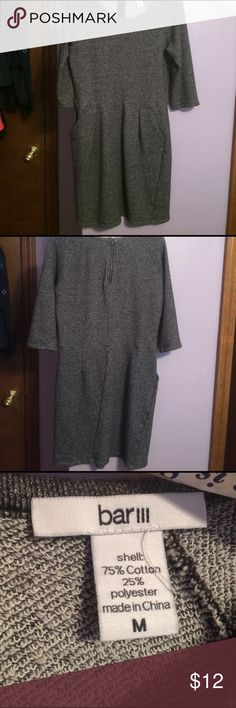 Grey mini dress Charcoal grey dress with two pockets in front. Very comfortable and perfect for occasions that require semi-professional attire. I'm 5'5'' and it comes about three inches above my knee. Dresses Mini