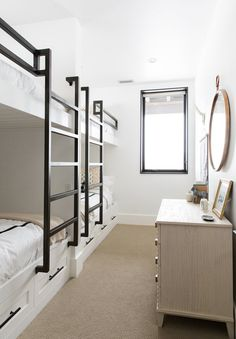A bright and neutral guest bedroom featuring custom-made bunk beds | archdigest.com