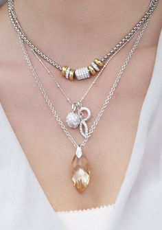 Beautifully Layered Necklaces from Touchstone Crystal by SWAROVSKI Top to bottom: the Bright Lights Slide Necklace, the Lunar Charm Necklace and the last is no longer available, but an comparable replacement is the Spellbound Pendant in Crystal Gold! http://www.mytouchstonecrystal.com/shannonlatif