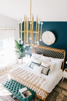 Jonathan Adler brass pendant light with 30 lights // love it with this modern boho bedroom and teal walls