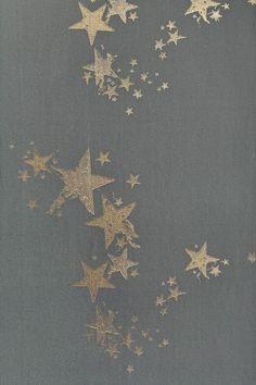Star wallpaper design by Barneby Gates in gunmetal grey and gold.