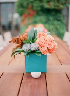 coral roses + succulents + bay leaves + astilbe // orange and turquoise wedding flower inspiration