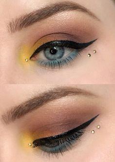 Colorful 3 tone eye makeup look with rose eyeshadow/brown eyeshadow, yellow inner corner highlight, blue waterline + under-eye color, and black eyeliner / cateye.