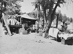 """Migratory children living in """"Rambler's Park."""" They have lived on the road for three years. Nine children in the family. Yakima Valley, Washington. Photograph by Dorothea Lange from the Library of Congress American Memory collection"""