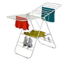 Clothes drying rack: Love that this has a place for shoes, too! Can't tell you how often the kid comes back from the lake with wet shoes :o