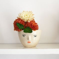 Ceramics with cute faces by Rami Kim, posted on the blog! http://www.artisticmoods.com/rami-kim/