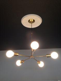 Gold and Brass Chandelier white globes modern mid century hanging light. Sputnik inspired light.