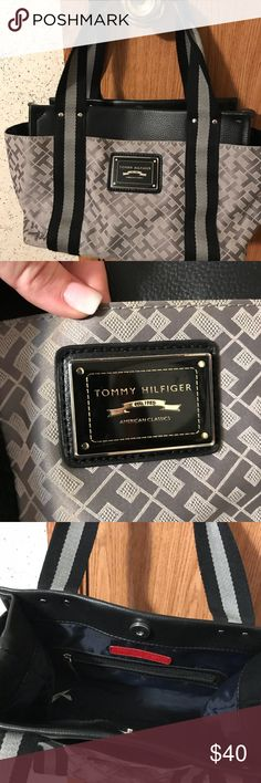 Tommy Hilfiger satchel Tommy Hilfiger canvas and leather satchel.  11in X 7in.  Exterior pockets on front and back and both ends.  Beautiful gray color with black trim. Tommy Hilfiger Bags Satchels