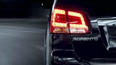 Tail Lights | Rear | 2013 Kia Sorento – The CUV's rear features rounded back and tail lamps set within the rear lift gate. For the SX trim, LED tail lamps are added that are brighter and consume less energy than typical lights.