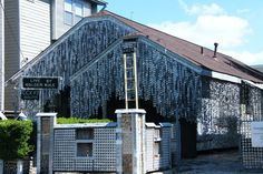 The-beer-can-house: Houston, Texas. In 1968, John Milkovisch got tired of mowing the grass so he decided to lay out beer cans as a new landscaping technique. Deciding that this idea wasn't enough, he lined his home's siding with flattened beer cans, which total over 50,000 as of today.