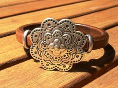women camel brown 10mm thick licorice leather  bracelet with sterling silver plated flower magnet  clasp on Etsy, $32.00