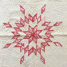 """This weekend I found this very worn baby quilt in a trunk at my parents' house. Four red stars in the corners and this larger one in the centre. Hand quilted in a baptist fan pattern. When I showed my Dad he got a bit teary-eyed and said """"That was my Grandmother's baby quilt."""" I was fortunate enough to know my Great-Grandmother briefly when I was a child. And this is exactly why I love quilts - because they hold stories and history that live beyond our years here. This particular quilt is…"""