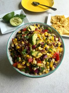 Sweet Corn Black Bean Salad is the perfect side dish to bring to your next BBQ, picnic or get together this summer.  The sweet corn pairs with black beans, fresh vegetables and avocado and is topped with a light cilantro dressing.  Use this as a salad, dip for chips or topping on grilled chicken or burgers. // A Cedar Spoon #ad
