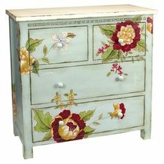 "Stow linens and craft supplies in this 4-drawer wood chest, featuring a weathered blue finish and multicolor floral motif.   Product: ChestConstruction Material: WoodColor: BlueFeatures: Four drawersDimensions: 33.75"" H x 34"" W x 16"" D"