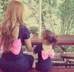 Matching mother daughter outfits.