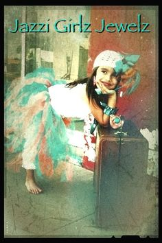 Cadence is wearing a handmade tutu and hair bow . She was styled by Jazzi Jewelz !!!