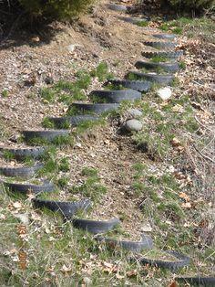 Stairs up a hill (made of tires) Steep Hillside Landscaping, Terraced Landscaping, Landscaping A Slope, Garden Crafts, Garden Projects, Garden Art, Garden Stairs, Terrace Garden, Backyard Sheds