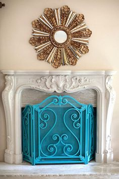 Aqua fireplace screen... If I can manage to convince my husband...