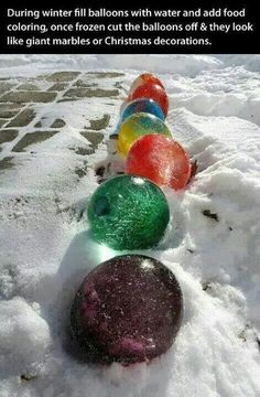 Full balloons with water and food coloring then freeze.  Bust balloons once frozen and you have Christmas yard decorations. Looks like Christmas lights.