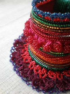 Gladiolus Cardinalis  ... Freeform Crochet Cuff  -  Red Green Orange Burgundy Indigo - Beaded Beadwork. $168,00, via Etsy.