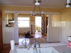 Opening up a craftsman kitchen to living area
