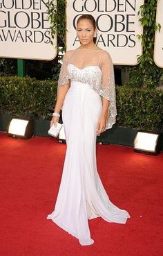 At the 2011 Golden Globes, Jennifer Lopez's look cost a whopping $5 million thanks to her Zuhair Murad custom gown, Louboutins, and a Harry Winston cuff decked out in more than 600 diamonds. She also wore $3 million Harry Winston earrings, a diamond ring, and a diamond cluster brooch in her hair. (Photo by: Stylecaster Pictures)