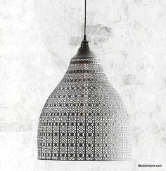 Roost Muse Pendant Lamp feature an intricate metal shade and textural finish that glitters with light play. Detailed punched patterns give ancient appeal.