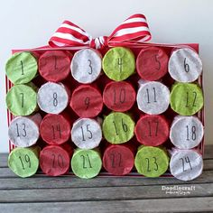 """TP Roll Christmas Countdown Advent Calendar!  Upcycle your toilet paper rolls and make this fun punch box countdown! Great for holidays or any other """"countdown""""!"""