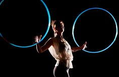 Christine Janak of Christine Janak Yoga & Performance Art and Christineyogart on instagram pops against the dark background of this photo by Michael Gildersleeve Photography. She lives in Decatur, Illinois, USA.