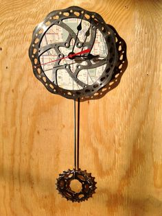 This is cool!! Recycled Bicycle Disc Brake Rotor Pendulum Clock by LlamaTradingCo, $40.00