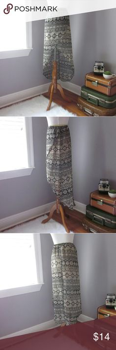 """High Low Aztec Skirt Tribal/Aztec print skit. Excellent condition. Gently worn. 100%  poly. Waist 11.5 unstretched. Length 16"""" in front 37"""" in back. Lined to 14.5 inches.  Bundle for best deals! Hundreds of items available for discounted bundles! You can get lots of items for a low price and one shipping fee!  Follow on IG: @the.junk.drawer Skirts High Low"""