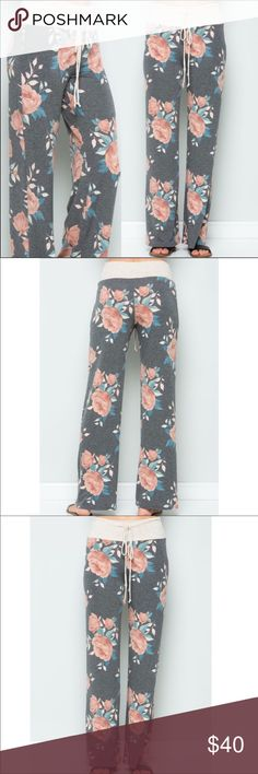 """Floral Long Pants With Drawstring Cute long floral pants with drawstring. Gray background color. Wide leg pants can be dressed up or down. Size XL. Waist 16"""" 43"""" long with a 32"""" inseam. 63% Polyester 34% Rayon 3% Spandex Pants Wide Leg"""