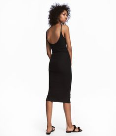 Black. Fitted, calf-length dress in thick, ribbed jersey. Narrow shoulder straps and low-cut back.