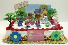 Amazon.com: Doc McStuffins Birthday Cake Topper Set Featuring Doc McStuffins, Donny McStuffins, Lambie, Stuffy the Dragon, Chilly the Snowma...