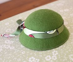 (10) HOW TO MAKE A DOLLS WOOL FELT HAT. Once the stiffener is dried, we get to embellish it! I chose this silk fabric with a fun print to make a band that ties in the back.