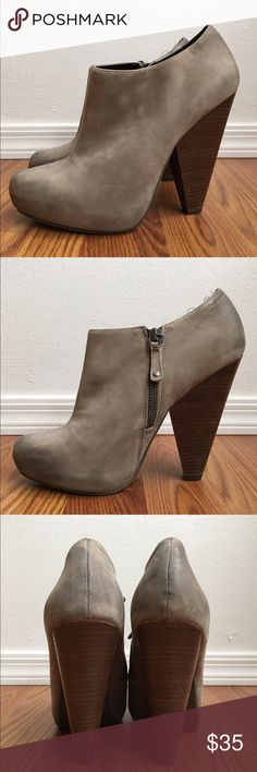 Trouve Taupe Ankle Bootie These modern ankle booties will make you stand out with their 4 1/2' heel and pointed toe. Taupe leather upper and wooden heel. Pictured slight discoloration at back of heel and toe. Fits true to size. Overall in good condition. Trouve Shoes Ankle Boots & Booties