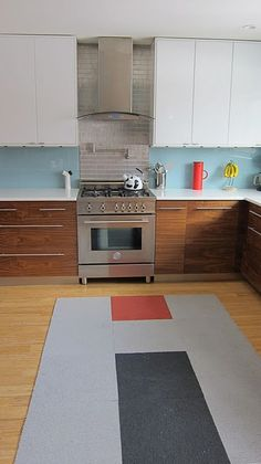Ikea:  Too  modern? Not sure. Like the colours and two tones cabinets though.  Cool backsplash too.  Wonder if it's glass?