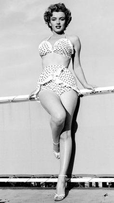 ❤ Marilyn Monroe ~*❥*~❤ The blonde bombshell dons a polka-dot bikini with ruffling details.